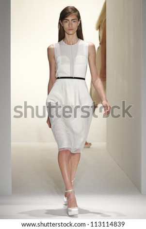 NEW YORK, NY - SEPTEMBER 13: A model walks the runway at the Calvin Klein Spring Summer 2013 collection presentation during Mercedes Benz Fashion Week on September 13, 2012 in New York City, USA - stock photo