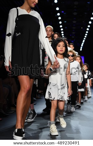 NEW YORK, NY - SEPTEMBER 13: A model walks the runway at the Comme Tu Es fashion show during New York Fashion Week on September 13, 2016 in New York City.