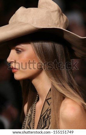 NEW YORK, NY - SEPTEMBER 09: A model walks the runway at the Donna Karan New York fashion show during Mercedes-Benz Fashion Week Spring 2014 on September 9, 2013 in New York City.
