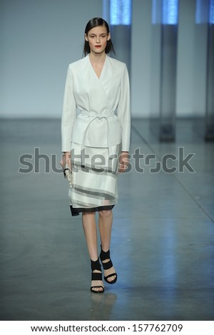 NEW YORK, NY - SEPTEMBER 06: A model walks the runway at the Helmut Lang Spring 2014 fashion show during Mercedes-Benz Fashion Week on September 6, 2013 in New York City.