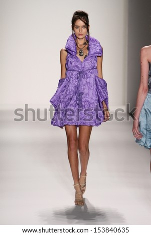 NEW YORK, NY - SEPTEMBER 07: A model walks the runway at the Katya Leonovich fashion show during Mercedes-Benz Fashion Week Spring 2014 at Lincoln Center on September 7, 2013 in New York City. - stock photo