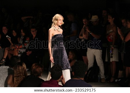 NEW YORK, NY - SEPTEMBER 06: A model walks the runway at the Luis Antonio fashion show during Mercedes-Benz Fashion Week Spring 2015 at Lincoln Center on September 6, 2014 in NYC - stock photo
