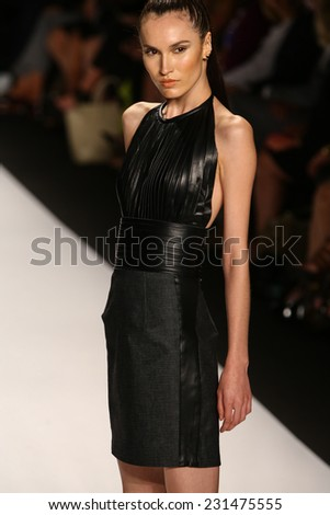 NEW YORK, NY - SEPTEMBER 05: A model walks the runway at the Project Runway (Kini Zamora) show during MBFW Spring 2015 at Lincoln Center on September 5, 2014 in NYC - stock photo