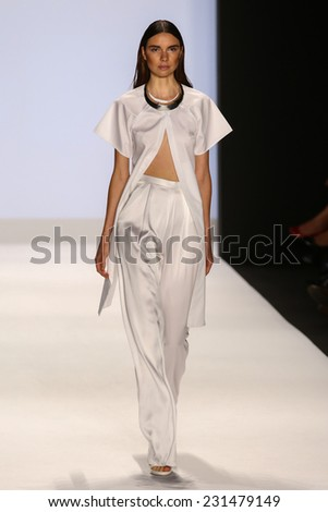 NEW YORK, NY - SEPTEMBER 05: A model walks the runway at the Project Runway (Sean Kelly) show during MBFW Spring 2015 at Lincoln Center on September 5, 2014 in NYC - stock photo