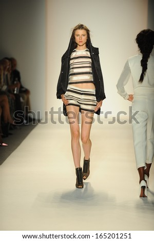 NEW YORK, NY - SEPTEMBER 11: A model walks the runway at the Rachel Zoe show during Spring 2014 Mercedes-Benz Fashion Week at The Studio at Lincoln Center on September 11, 2013 in New York City. - stock photo