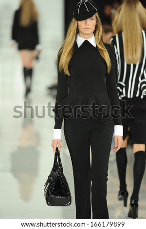 NEW YORK, NY - SEPTEMBER 12: A model walks the runway at the Ralph Lauren fashion show during Mercedes-Benz Fashion Week Spring 2014 on September 12, 2013 in New York City.