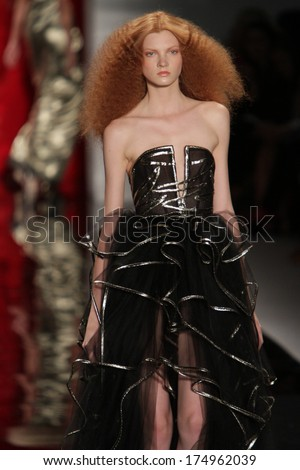 NEW YORK, NY - SEPTEMBER 09: A model walks the runway at the Reem Acra show during Spring 2014 Mercedes-Benz Fashion Week at The Stage at Lincoln Center on September 9, 2013 in New York City. - stock photo