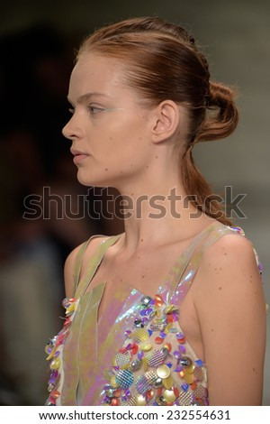 NEW YORK, NY - SEPTEMBER 06: A model walks the runway at the Son Jung Wan fashion show during Mercedes-Benz Fashion Week Spring 2015 at Lincoln Center on September 6, 2014 in NYC