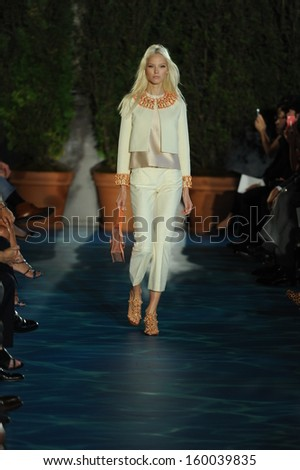 NEW YORK, NY - SEPTEMBER 10: A model walks the runway at the Tory Burch show during Spring 2014 Mercedes-Benz Fashion Week at David H. Koch Theater on September 10, 2013 in New York City.