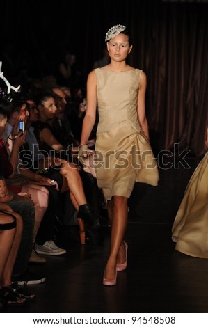 NEW YORK, NY - SEPTEMBER 14: A model walks the runway at the Victor De Souza Spring 2012 fashion show during Mercedes-Benz Fashion Week at Slate on September 14, 2011 in New York City.