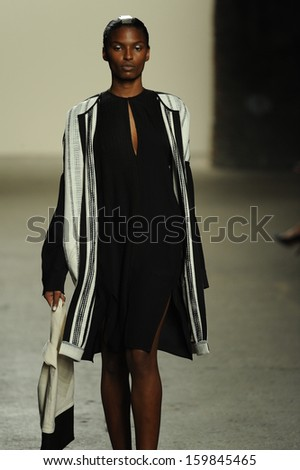 NEW YORK, NY - SEPTEMBER 09: A model walks the runway at the Zero + Maria Cornejo fashion show during Mercedes-Benz Fashion Week Spring 2014 at Eyebeam on September 9, 2013 in New York City.