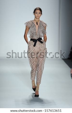 NEW YORK, NY - SEPTEMBER 06: A model walks the runway at the Zimmermann Spring 2014 fashion show during Mercedes-Benz Fashion Week at Lincoln Center on September 6, 2013 in New York City.
