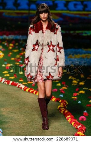 NEW YORK, NY - SEPTEMBER 08: A model walks the runway at Tommy Hilfiger Women's fashion show during Mercedes-Benz Fashion Week Spring 2015 at Park Avenue Armory on September 8, 2014 in New York City. - stock photo