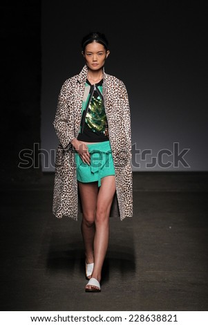 NEW YORK, NY - SEPTEMBER 07: A model walks the runway at Tracy Reese during Mercedes-Benz Fashion Week Spring 2015 at Art Beam on September 7, 2014 in New York City. - stock photo