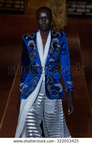 NEW YORK, NY - SEPTEMBER 17: A model walks the runway during the Marc Jacobs Runway Spring 2016 New York Fashion Week: The Shows at Ziegfeld Theater on September 17, 2015 in New York City. - stock photo