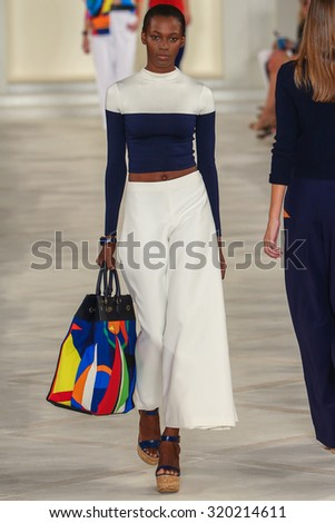 NEW YORK, NY - SEPTEMBER 17: A model walks the runway wearing Ralph Lauren Spring 2016 during New York Fashion Week: The Shows at Skylight Clarkson Sq on September 17, 2015 in New York City. - stock photo