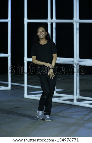 NEW YORK, NY - SEPTEMBER 07: Alexander Wang greets the audience after presenting the Alexander Wang Spring 2014 fashion show during Mercedes-Benz Fashion Week in New York City on September 7, 2013 . - stock photo