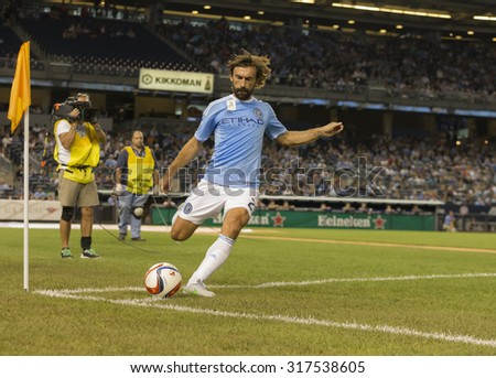 New York, NY - September 16, 2015: Andrea Pirlo (21) of NYC FC performs corner during game between New York City FC and Toronto FC at Yankee Stadium - stock photo