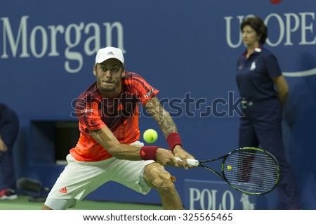 New York, NY - September 2, 2015: Andreas Haider-Maurer of Austria returns ball during 2nd round match against Novak Djokovic of Serbia at US Open Championship  - stock photo
