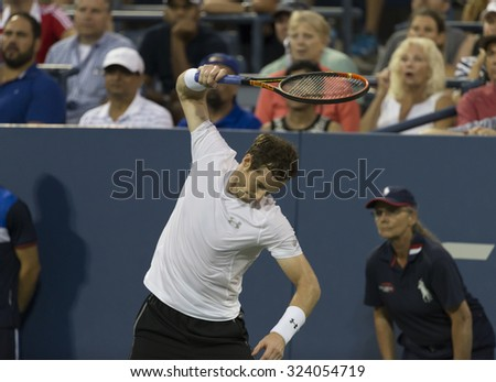 New York, NY - September 7, 2015: Andy Murray of Great Britain breaks racquet during 4th round match against Kevin Andreson of South Africa at US Open Championship - stock photo