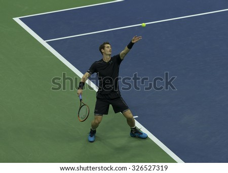 New York, NY - September 1, 2015: Andy Murray of Great Britain serves ball during 1st round match against Nick Kyrgios of Australia at US Open Championship - stock photo