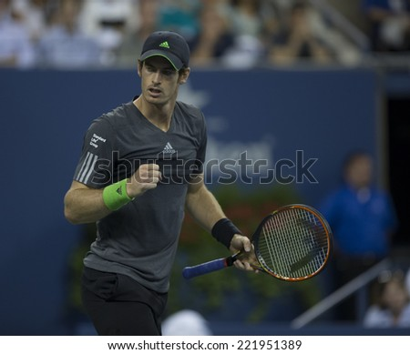NEW YORK, NY - SEPTEMBER 3, 2014: Andy Murray of United Kingdom reacts during quarterfinal match against Novak Djokovic of Serbia at US Open championship in Flushing Meadows USTA Tennis Center - stock photo