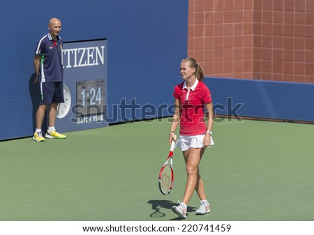 NEW YORK, NY - SEPTEMBER 7, 2014: Anhelina Kalinina of Ukraine reacts during final girls juniors match against Marie Bouzkova of Czech Republic at US Open championship in Flushing Meadows USTA Center - stock photo