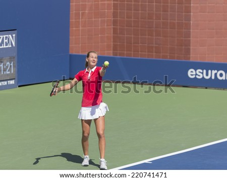 NEW YORK, NY - SEPTEMBER 7, 2014: Anhelina Kalinina of Ukraine serves ball during final girls juniors match against Marie Bouzkova of Czech Republic at US Open championship in Flushing Meadows - stock photo