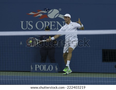 NEW YORK, NY - SEPTEMBER 2, 2014: Bautista Agut of Spain returns ball during 4th round match against Roger Federer of Switzerland at US Open in Flushing Meadows USTA Tennis Center - stock photo