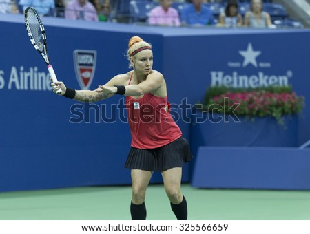 New York, NY - September 4, 2015: Bethanie Mattek-Sands of USA returns ball during 3rd round match against Serena Williams of USA at US Open Championship - stock photo