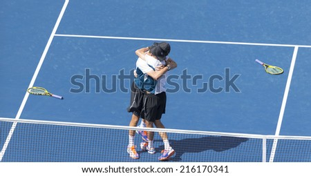 NEW YORK, NY - SEPTEMBER 7, 2014: Bryan brothers of USA celebrates winning final mens doubles match against Marc Lopez & Marcel Granollers of Spain at US Open championship in Flushing Meadows - stock photo