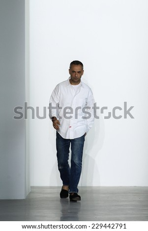 NEW YORK, NY - SEPTEMBER 11: Fashion designer Francisco Costa appears on the runway at the Calvin Klein Collection fashion show during MBFW Spring 2015 at Spring Studios on September 11, 2014 in NYC.