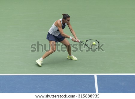 New York, NY - September 12, 2015: Flavia Pennetta of Italy returns ball during final match against Roberta Vinci of Italy at US Open Championship
