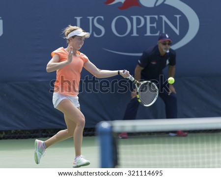 New York, NY - September 11, 2015: Francesca Di Lorenzo of USA returns ball during quarterfinal against Iryna Shymanovich of Belarus at junior girls US Open