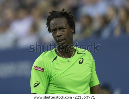 NEW YORK, NY - SEPTEMBER 4, 2014: Gael Monfils of France reacts during quarterfinal match against Roger Federer of Switzerland at US Open championship in Flushing Meadows USTA Tennis Center - stock photo