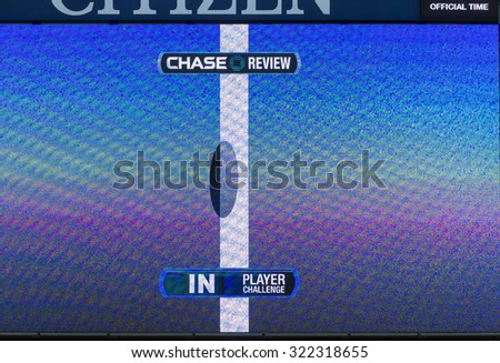 New York, NY - September 9, 2015: HawkEye technoloy display on ASh stadium during quarterfinal between Richard Gasquet of France & Roger Federer of Switzerland at US Open Championship - stock photo