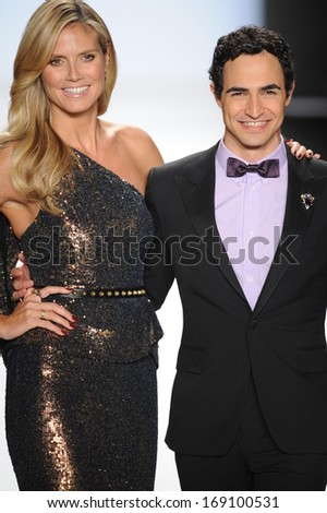 NEW YORK, NY - SEPTEMBER 06: Heidi Klum and Zac Posen walk the runway at the Project Runway show during Spring 2014 Mercedes-Benz Fashion Week at Lincoln Center on September 6, 2013 in New York City. - stock photo