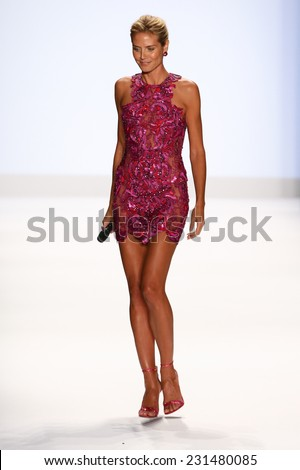 NEW YORK, NY - SEPTEMBER 05: Heidi Klum greets the audience at Project Runway during Mercedes-Benz Fashion Week Spring 2015 at Lincoln Center on September 5, 2014 in NYC - stock photo