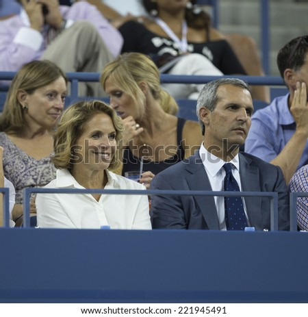 NEW YORK, NY - SEPTEMBER 3, 2014: Katie Couric & John Molner attend quarterfinal match between Flavia Pennetta of Italy & Serena Williams of USA at US Open championship in Flushing Meadows USTA Center