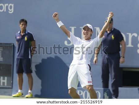 NEW YORK, NY - SEPTEMBER 6, 2014: Kei Nishikori of Japan celebrates victory of semifinal match against Novak Djokovic of Serbia at US Open championship in Flushing Meadows USTA Tennis Center - stock photo