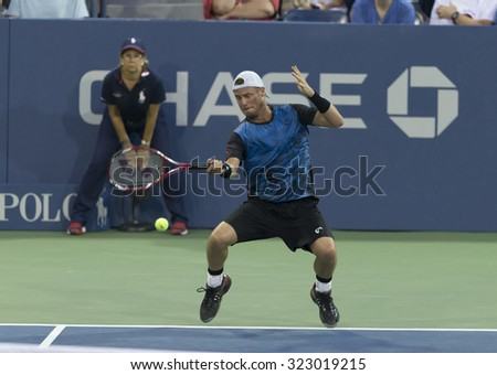 New York, NY - September 3, 2015: Lleyton Hewitt of Australia returns ball during 2nd round match against Bernard Tomic of Australia at US Open championship - stock photo