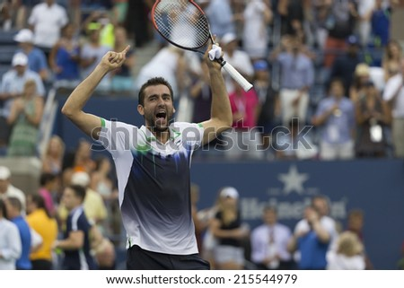 NEW YORK, NY - SEPTEMBER 6, 2014: Marin Cilic of Serbia celebrates victory of semifinal match against ROger Federer of Switzerland at US Open championship in Flushing Meadows USTA Tennis Center - stock photo