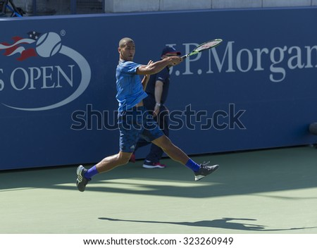 New York, NY - September 7, 2015: Michael Mmoh of USA returns ball during 1st round junior boys match against Evan Furness of France at US Open Championship
