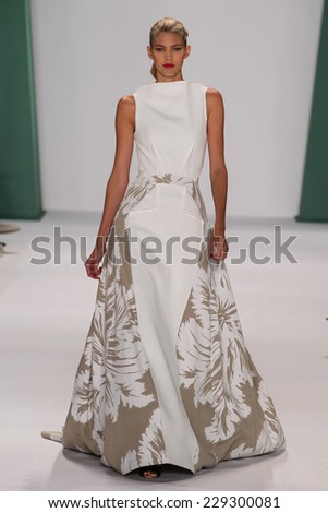 NEW YORK, NY - SEPTEMBER 08: Model Devon Windsor walk the runway at the Carolina Herrera fashion show during MBFW Spring 2015 at The Theatre at Lincoln Center on September 8, 2014 in NYC. - stock photo