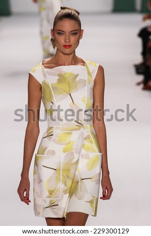 NEW YORK, NY - SEPTEMBER 08: Model Martha Hunt walk the runway at the Carolina Herrera fashion show during MBFW Spring 2015 at The Theatre at Lincoln Center on September 8, 2014 in NYC. - stock photo