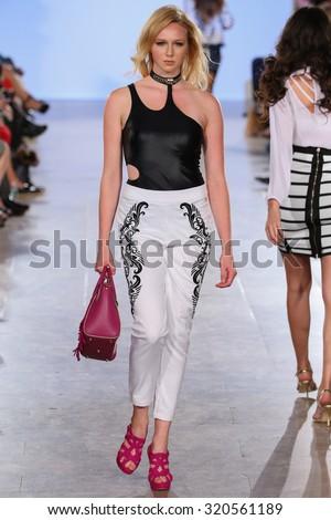 NEW YORK, NY - SEPTEMBER 13: Model walks Carmen Steffens runway at the FTL Moda Spring 2016 during NYFW at Vanderbilt Hall at Grand Central Terminal, on September 13, 2015 in NYC. - stock photo