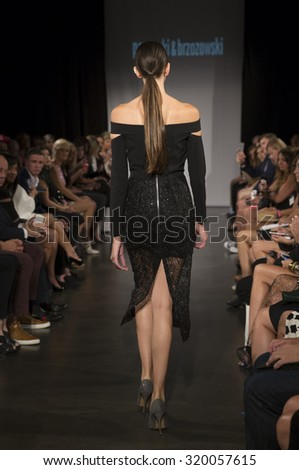 New York, NY - September 8, 2015: Model walks runway for Polish-American Fashion Foundation show by Marcin Paprocki & Mariusz Brzozowski at New Museum - stock photo