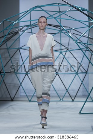 New York, NY - September 16, 2015: Model walks runway for SUNO collection by Max Osterweis & Erin Beatty during New York Spring/Summer 2016 fashion week at Clarckson Square - stock photo