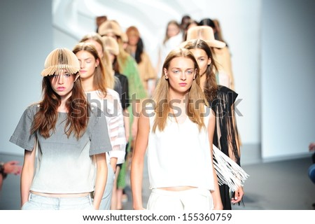NEW YORK, NY - SEPTEMBER 07: Models walk the runway finale at the Tibi Spring 2014 fashion show during Mercedes-Benz Fashion Week at at Pier 59, in New York City on September 7, 2013. - stock photo