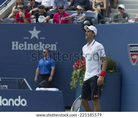 NEW YORK, NY - SEPTEMBER 6, 2014: Novak Djokovic of Serbia reacts ball during semifinal match against Kei Nishikori of Japan at US Open championship in Flushing Meadows USTA Tennis Center - stock photo